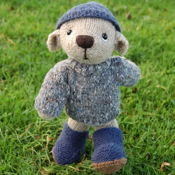 Our lovely Portland bear, hand knitted from pure hand spun wool wearing his cosy hat, jumper and boots