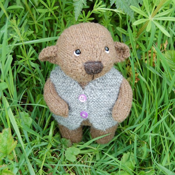 Cute little bear, hand knitted from pure Castlemilk Moorit hand spun wool