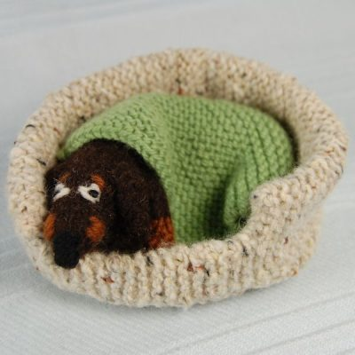 Little knitted dachshund