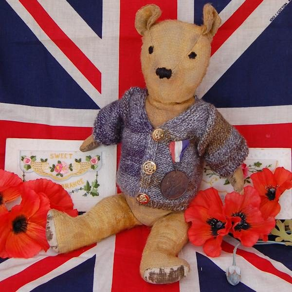 The lovely Archibald bear proudly wearing his medal and hand knitted jumper.