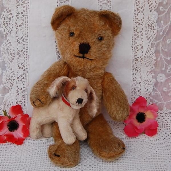 Having a little Steiff dog is a huge responsibility but we have the perfect bear to take care of him!