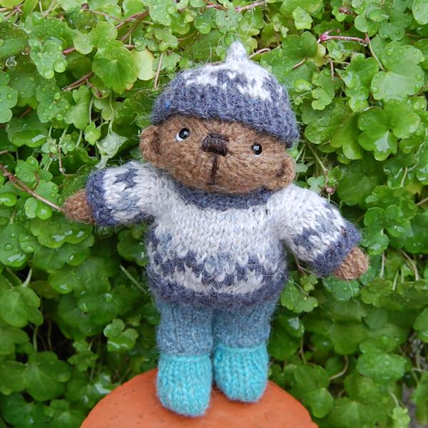 The adorable little smurf hand knitted in pure Castlemilk Moorit wool