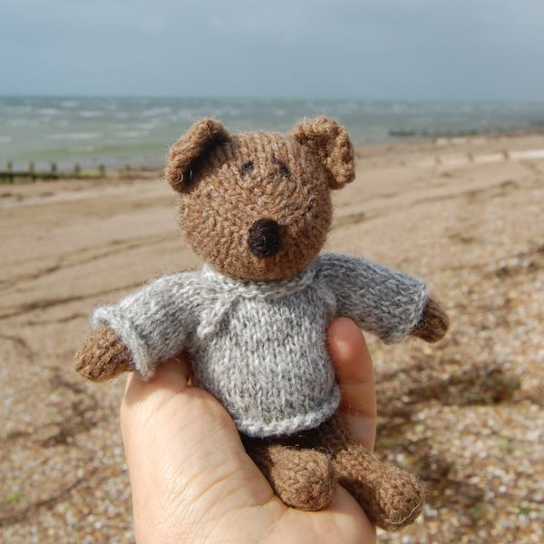 Cute little Cadbury, hand knitted teddy bear made from Castlemilk Moorit wool