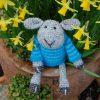 The very cute Seamus sheep admiring the Spring mini Daffs, he is hand crocheted in pure Shetland wool