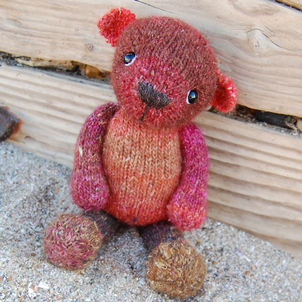 Cute little Ember knitted in uniquely hand dyed wool