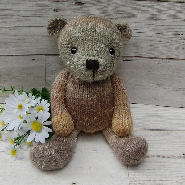The beautiful Walnut, a one-of-a-kind teddy bear knitted in hand dyed wool