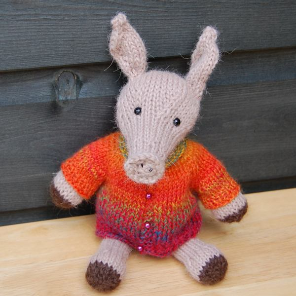 The adorable Alan aardvark designed and hand knitted by The Knitted Bear Co and made from the softest alpaca wool