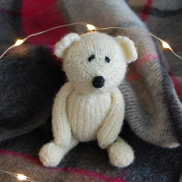 Miniature hand knitted teddy bear made from pure Cotswold wool