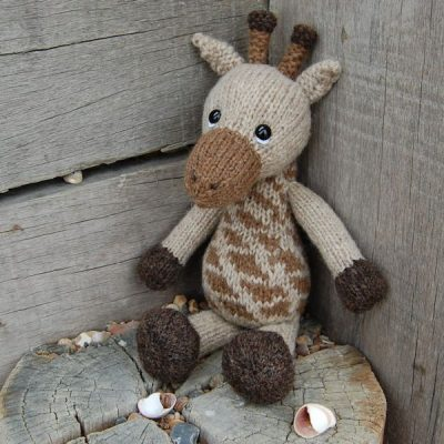 Our adorable little giraffe hand knitted from pure https://www.theknittedbearcompany.co.uk/admin/#tab-imageShetalnd hand spun wool