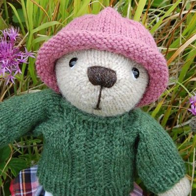 The very cute Imogen, our Highland teddy bear, looking adorable in her little tartan skirt