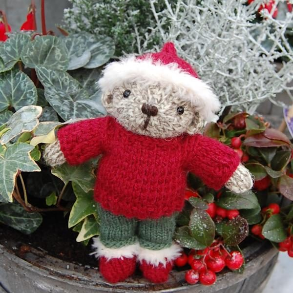 Cute little Henry, a pocket size hand knitted teddy bear