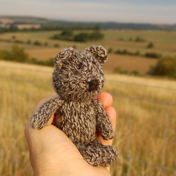 Jacob wool knitted teddy bear Jack watching the sunrise