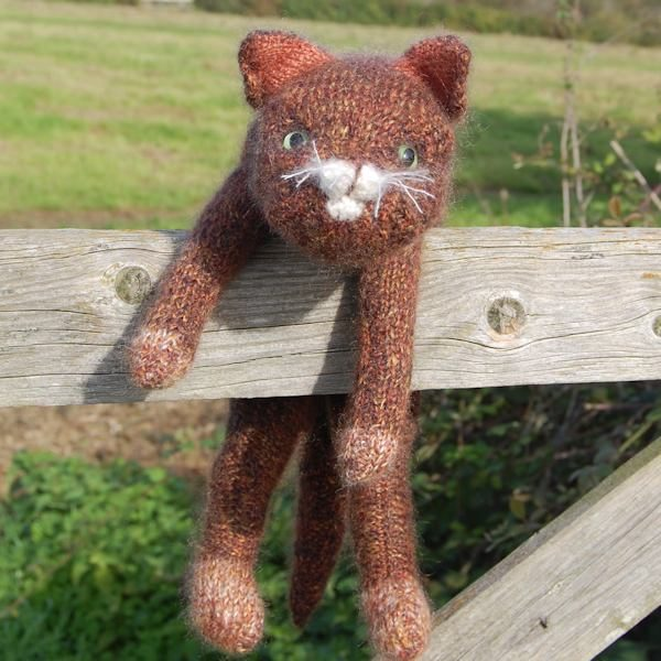 Trampuss hanging around! Charming ginger cat hand knitted by The Knitted Bear Company