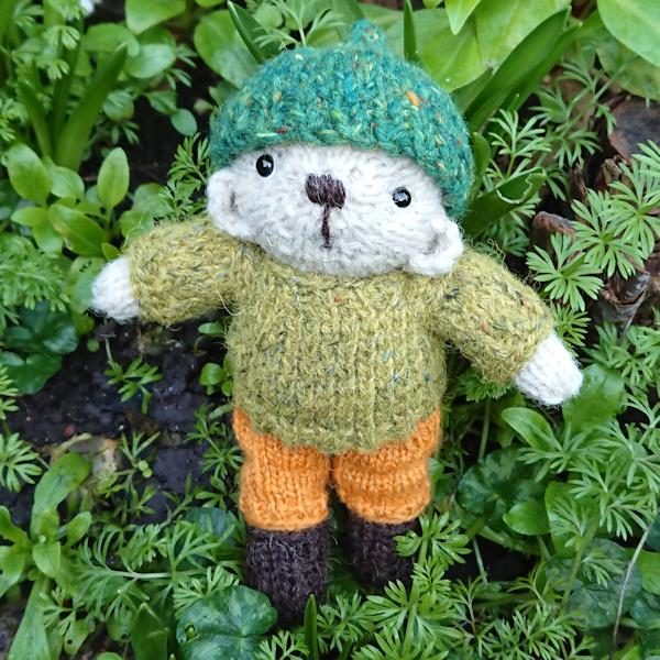 The very cute little Henry, hand knitted pocket size teddy bear made from pure Swaledale wool