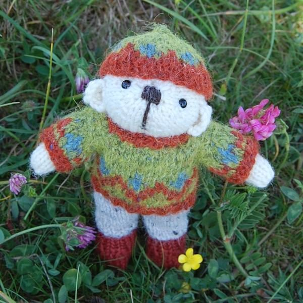 Cute little Thomas a hand knitted teddy bear in rare breed Portland wool