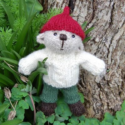 Owain, a hand made teddy bear knitted from rare breed Swaledale wool