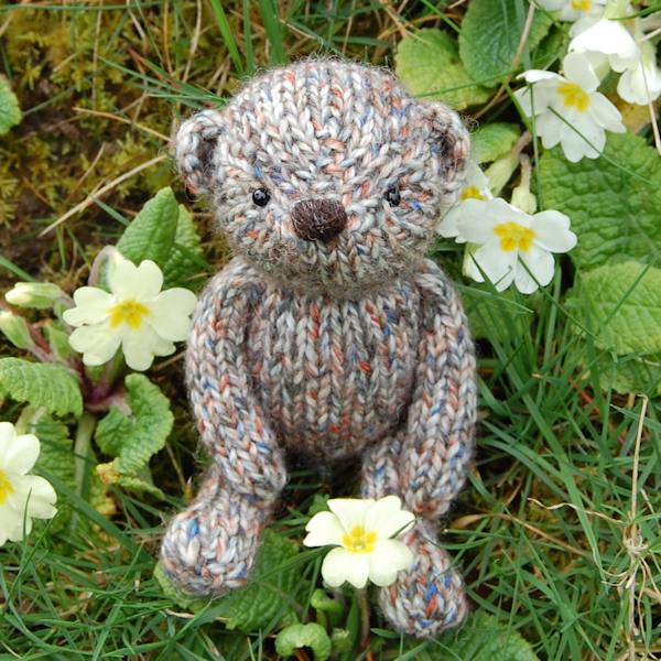 Cute little Penrose, a pocket size teddy bear hand knitted in pure Shetland Island tweed wool