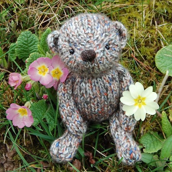Cute little Penrose, a pocket size teddy bear hand knitted in pure Shetland Island tweed wool