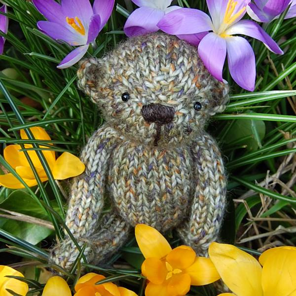 Cute little Ambrose, a pocket size teddy bear hand knitted in pure Shetland Island tweed wool