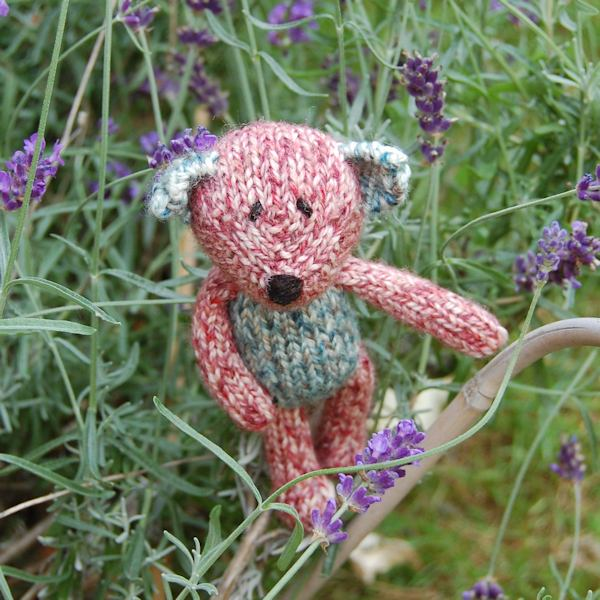 Cute little Pierre, a hand knitted teddy bear in Shetland wool and filled with organic lavender