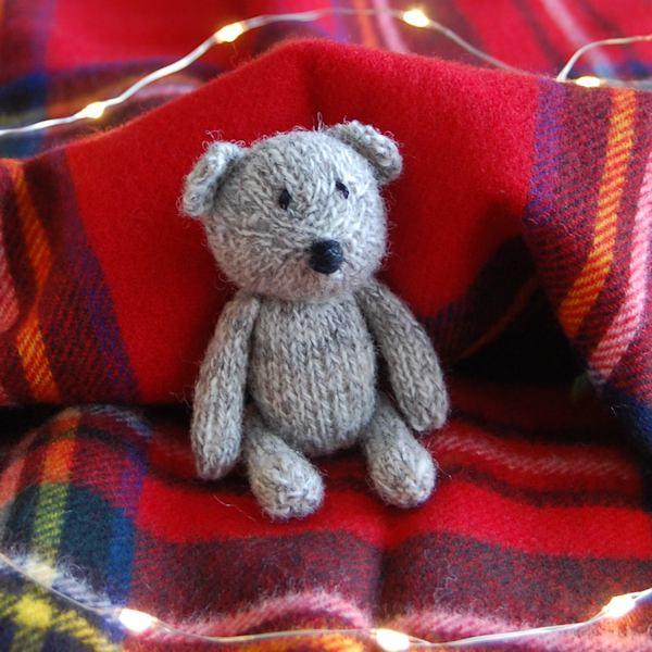 Miniature hand knitted teddy bear made from organic Shetland wool