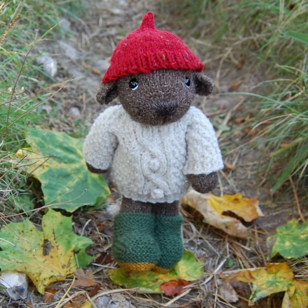 Our lovely Thornton bear, hand knitted from pure hand spun Soay wool, wearing his cosy hat, jumper and boots