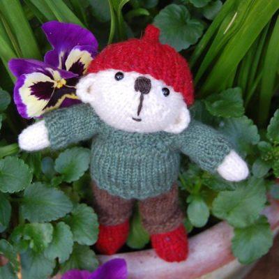 Bryn a hand made teddy bear knitted in Shetland hand spun wool