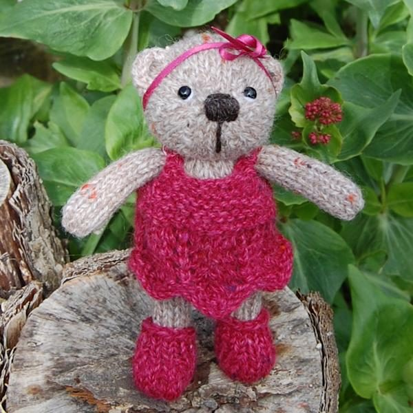 Ella a hand made teddy bear knitted in weed wool