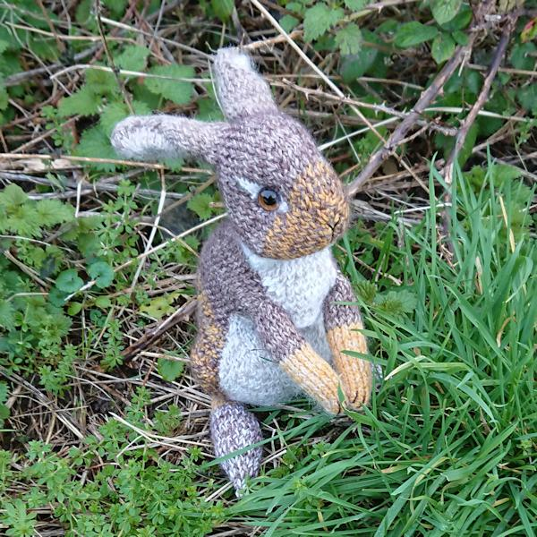 Adorable Bramble, a wild rabbit hand knitted in pure wool, alpaca and mohair