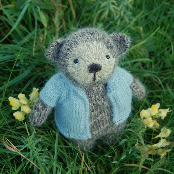 Shy little Jacob wool teddy bear