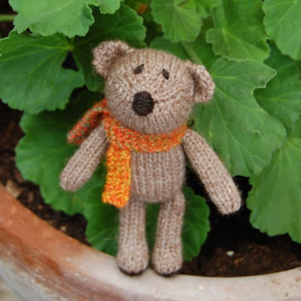 Meet Luigi, our super cute Little Scraps teddy Bear. hand knitted in pure soft alpaca wool this little one measures just 5 inches in height.