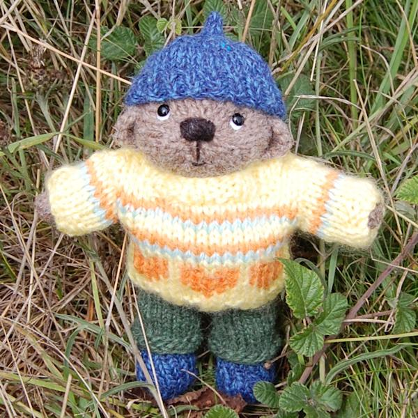 The adorable little pocket size teddy bear Huxley, hand knitted in rare breed, hand spun Manx Loaghtan wool
