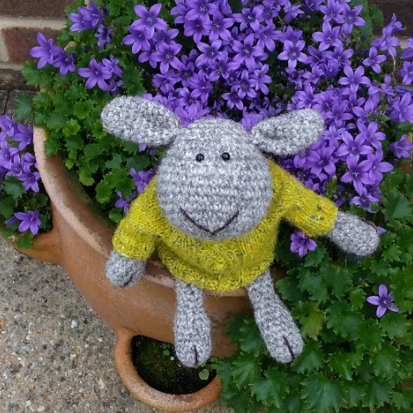 Little North Ronaldsay hand crochet sheep wearing his Aran wool jumper - The Knitted Bear Company