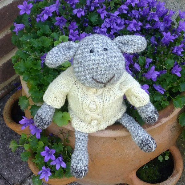 The gorgeous Douglas sheep hand crochet in pure wool and wearing his aran jumper - The Knitted Bear Company