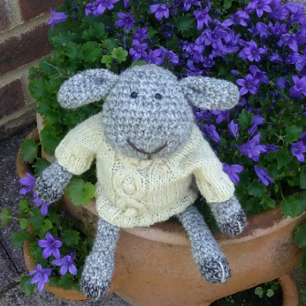 The gorgeous Douglas sheep hand crochet in pure wool and wearing his aran jumper