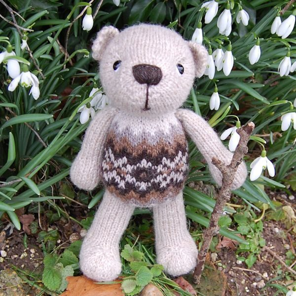 Our lovely Finley, hand knitted from pure hand spun Shetland wool, is a traditional Fair Isle teddy bear