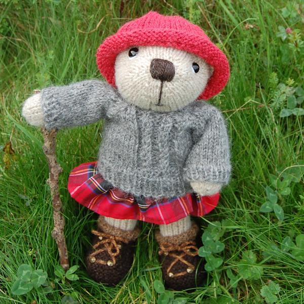 The very cute Poppy, our Highland teddy bear, looking adorable in her little tartan skirt
